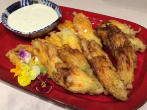 Squash blossoms - filled with shrimp or herb cheese, served with a cilantro serrano cream