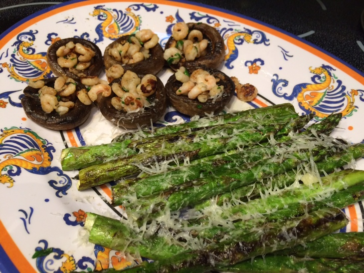 Grilled shrimp-stuffed mushrooms and asparagus